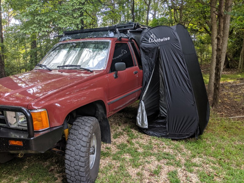 Wolfwise shower tent and road shower in use while truck camping