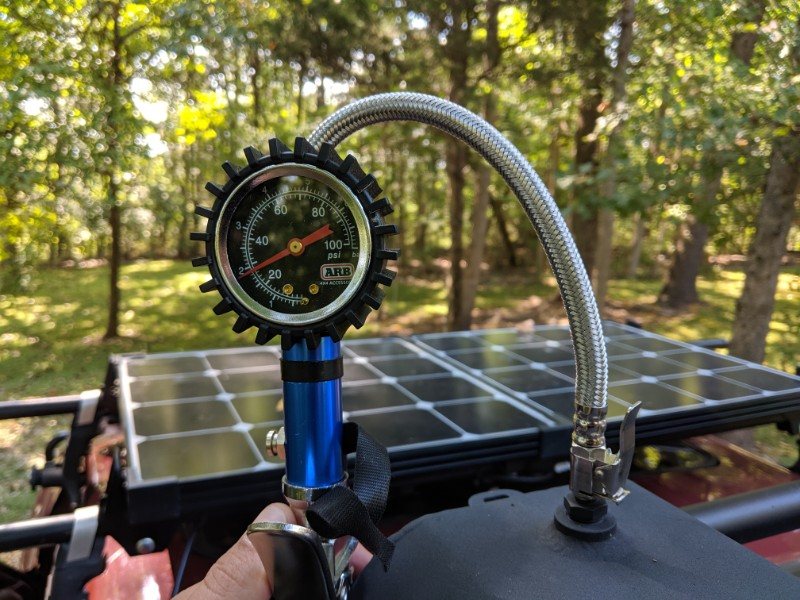 pressurizing the road shower portable camp shower while truck camping