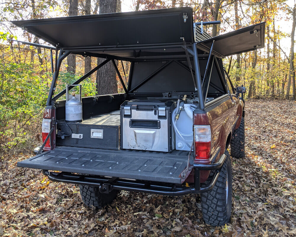 Finished homemade DIY truck camper build with all fixtures installed for overlanding travel
