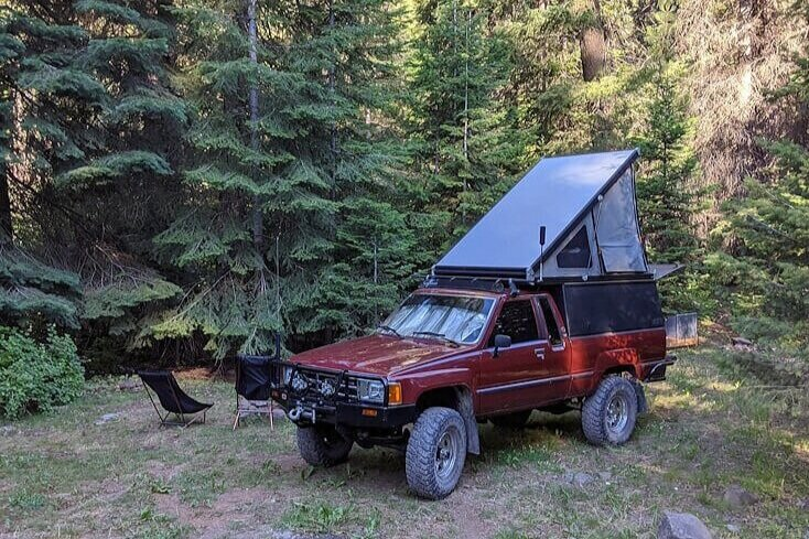 Toyota with a Go Fast Camper at free campsite in Idaho's Payette National Forest.