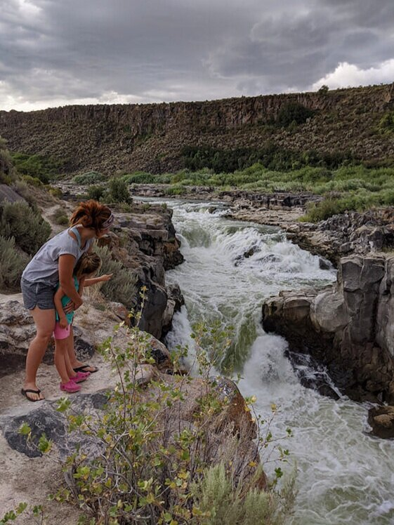 Woman and child visiting Cauldron Linn waterfall in Idaho near free camping sites.