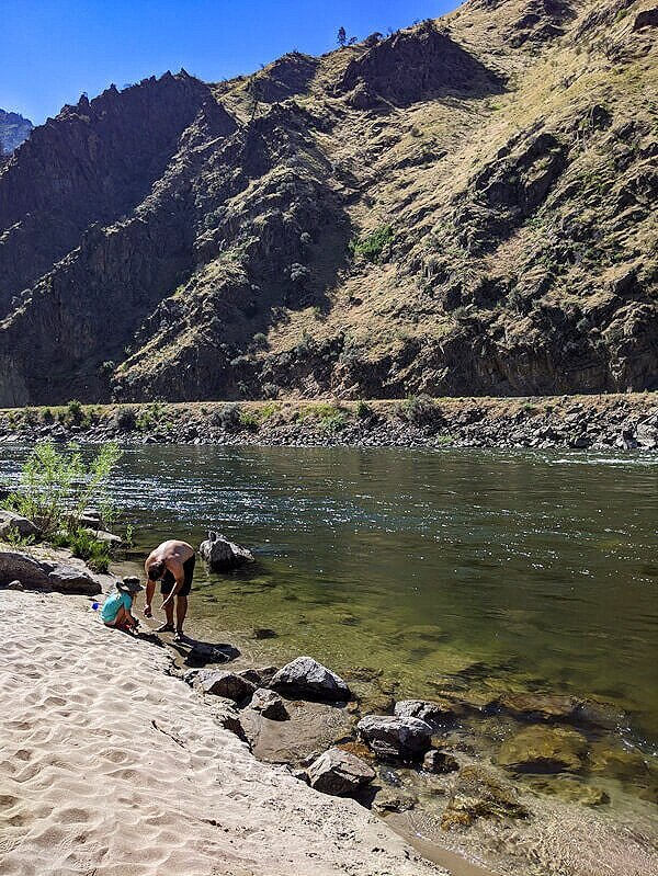 Family beach day on the Salmon River near free camping in Riggins, Idaho.