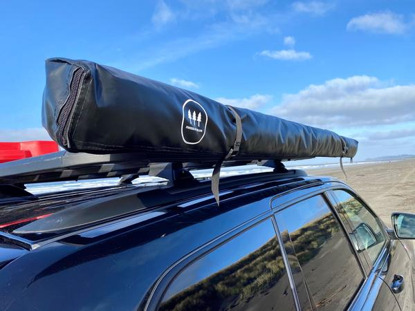 Pioneer Overland Awning roof rack accessory attached to roof rack.
