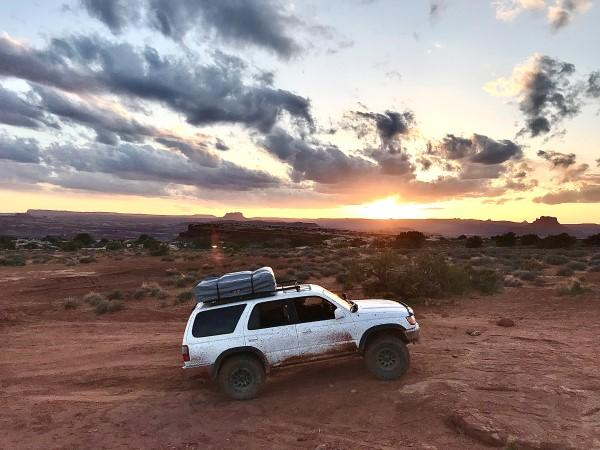 Off-Road 4Runner rock crawling with rooftop tent.