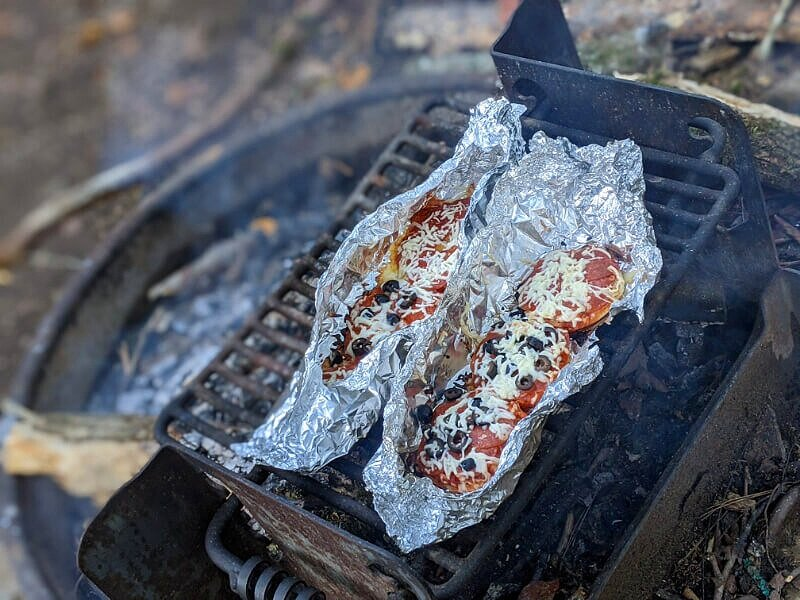 easy campfire pizza on bagels wrapped in foil for cooking