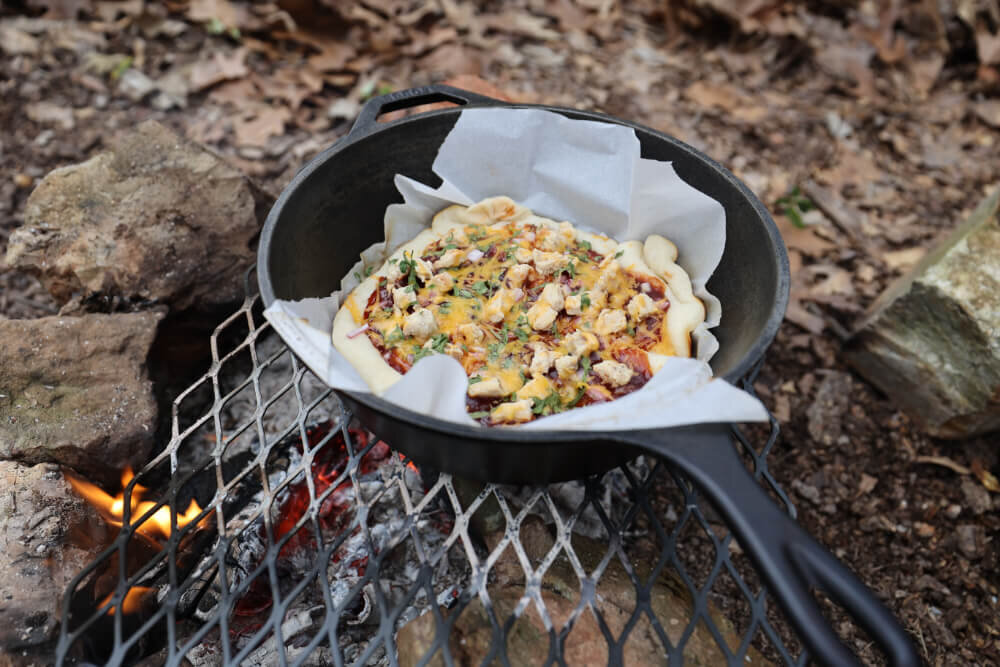 how to bake dutch oven camping pizza