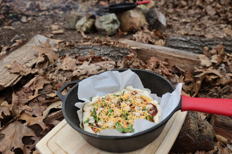 easy camping pizza cooked as dutch oven pizza