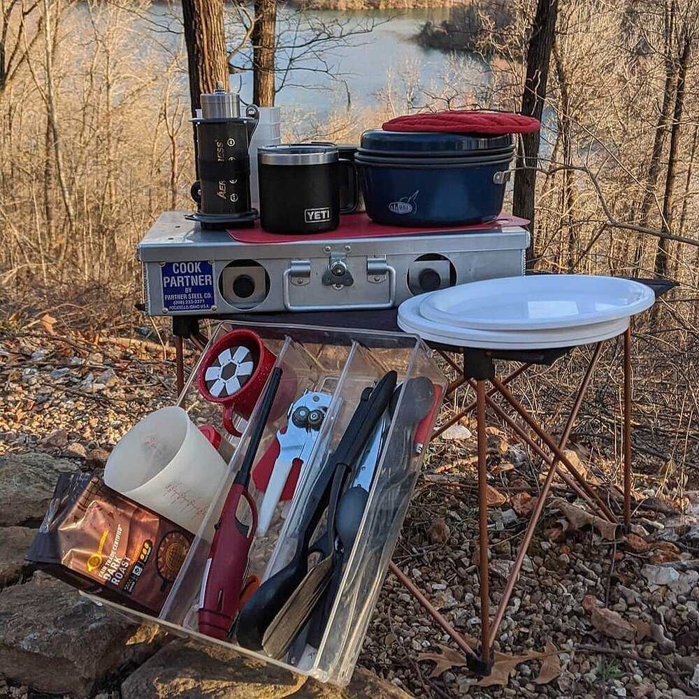 Camping kitchen supplies from camping checklist displayed.