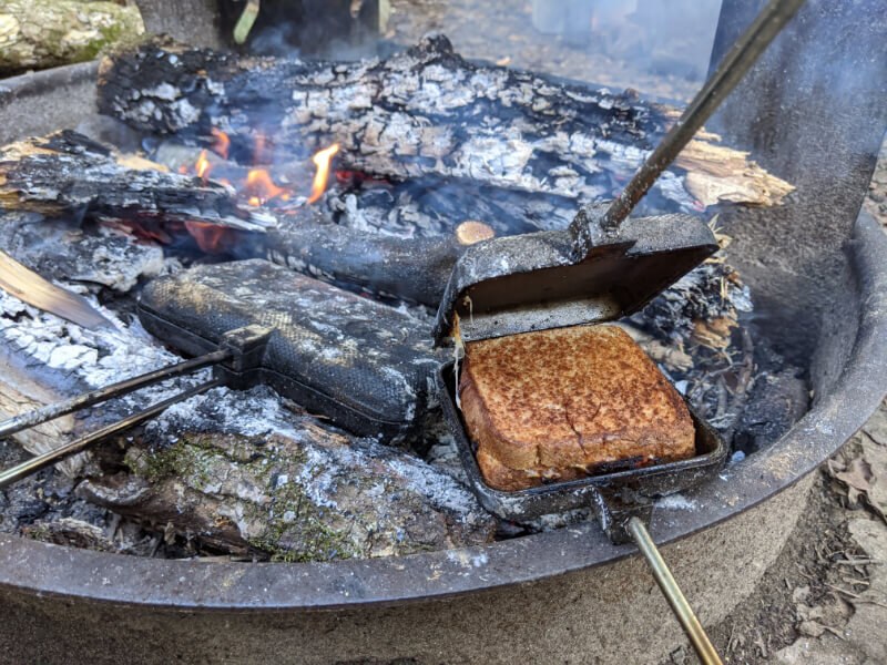 how to make pie iron pizza or pudgy pie pizza while camping
