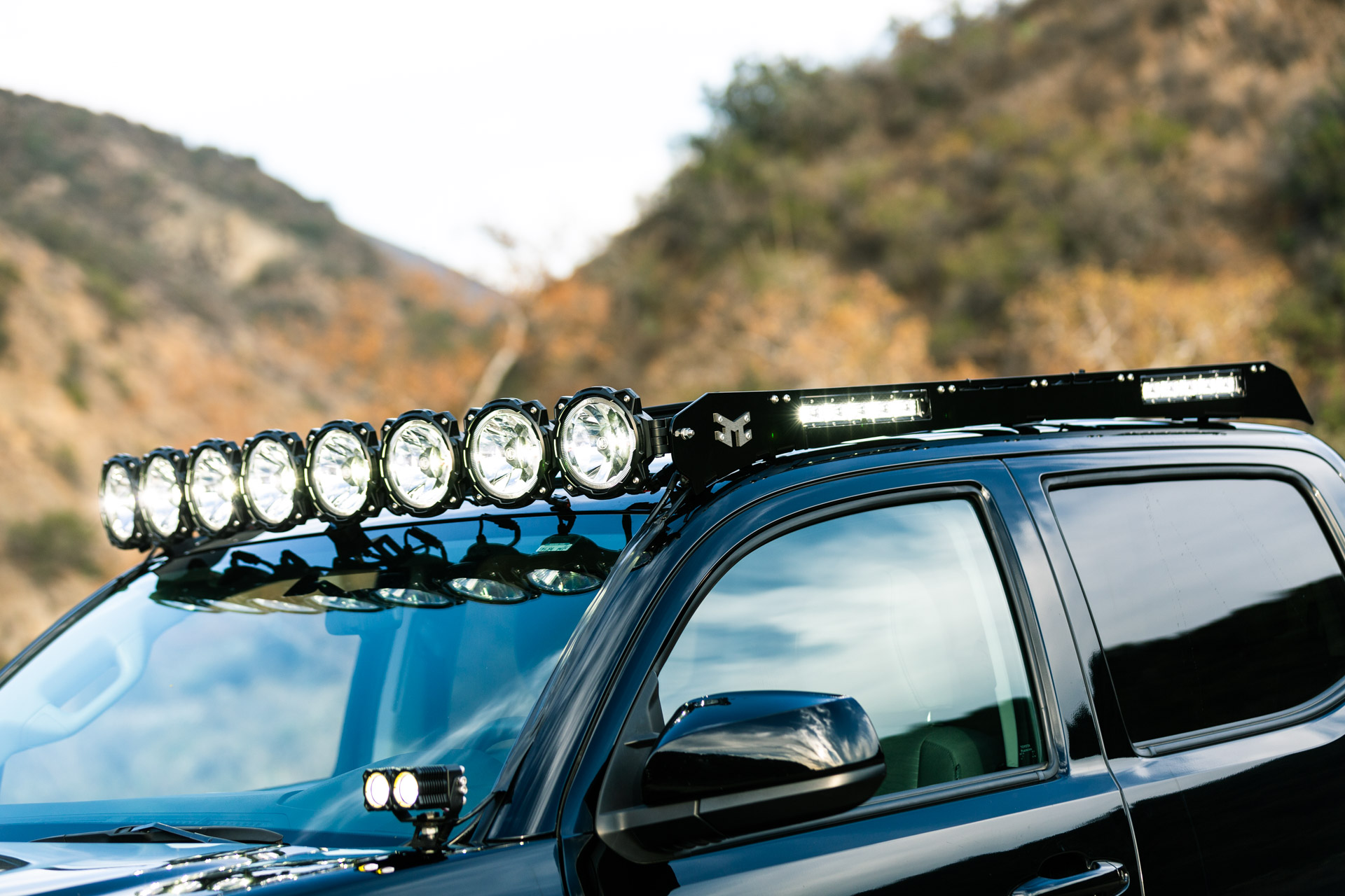 Black KC Toyota Tacoma with Roof Rack & Integrated Lighting - Image #02
