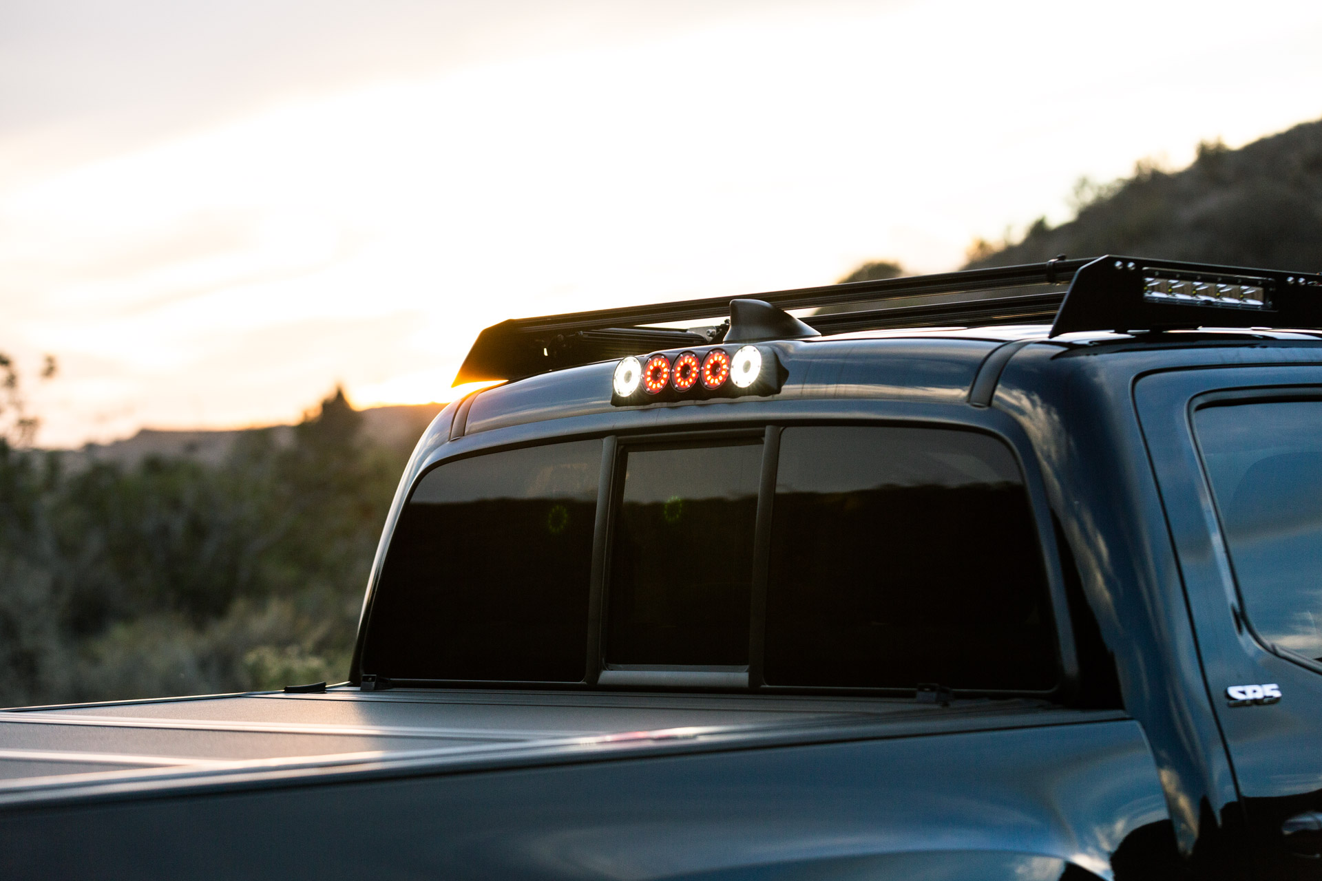 Black KC Toyota Tacoma with Roof Rack & Integrated Lighting - Image #03