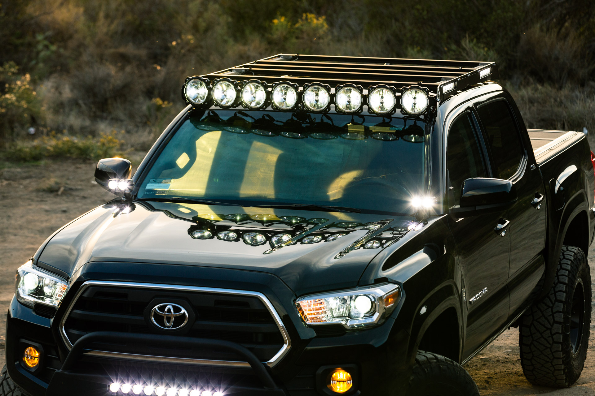 Black KC Toyota Tacoma with Roof Rack & Integrated Lighting - Image #04