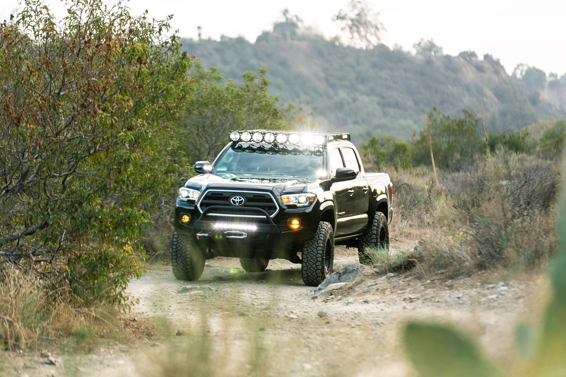 Black KC Toyota Tacoma with Roof Rack & Integrated Lighting - Image #05